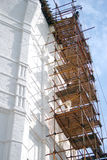 White monastery tower under reconstruction Stock Photography