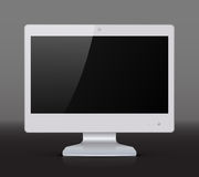 White monitor isolated on dark background Royalty Free Stock Images