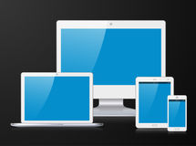 White monitor, laptop, mobile phone and tablet PC with blue screen. Electronic silver devices with blue, shiny screens isolated on black background, desktop Royalty Free Stock Photos