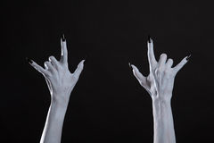 White monster hands showing heavy metal sign Royalty Free Stock Photo