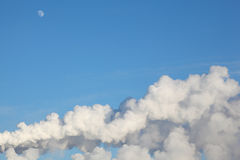 White moon, clouds and smoke from heat Royalty Free Stock Photography