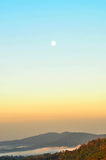 Moon in the morning. The white moon in the sky in the morning with the sea of mist Royalty Free Stock Photos