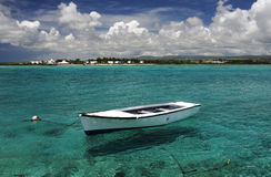 White moored boat and turquoise Indian Ocean, Mauritius. Royalty Free Stock Photography