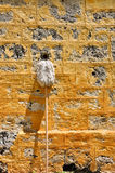 White Mop Leans on Limestone Wall Royalty Free Stock Photo