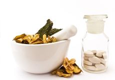 White mortar and pestle. Herbals, pills and pharmacy bottle stock photography