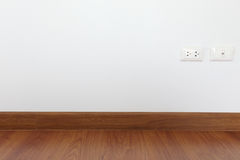 White mortar wall and wood floor Stock Image