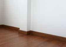 White mortar wall and wood floor Royalty Free Stock Photo