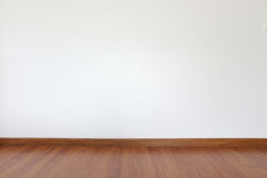 White mortar wall and wood floor. In the room Stock Photography