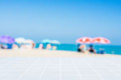 White mosaic floor and blurred beach atmosphere Stock Images