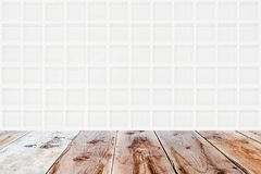 White mosaic glassy wall and brown wooden floor. Architectual background made of white mosaic glassy wall and brown wooden floor Stock Image