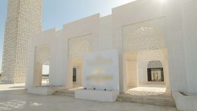 White mosque in Ajman timelapse hyperlapse, United Arab Emirates. Entrance to White mosque in Ajman timelapse hyperlapse with sun, United Arab Emirates royalty free stock images