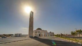 White mosque in Ajman timelapse hyperlapse, United Arab Emirates. White mosque in Ajman timelapse hyperlapse with sun, United Arab Emirates royalty free stock photos