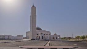 White mosque in Ajman timelapse hyperlapse, United Arab Emirates. White mosque in Ajman timelapse hyperlapse with sun, United Arab Emirates stock photos