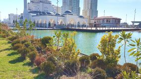 White mosque in a beautiful lake and green plants and trees. At istanbul , turkey stock video footage
