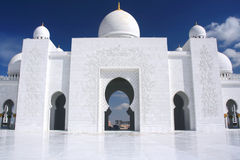 White mosque with cloudy blue sky. In Abu Dhabi Stock Photography