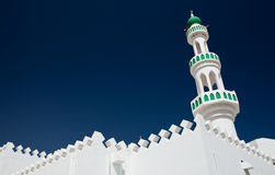 White mosque with minaret against blue sky Royalty Free Stock Image