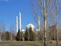 White mosque in the spring park. Picture taken in the spring park in which there is a large mosque of white stone stock photo