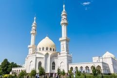 Large white mosque on blue sky background. White mosque in Tatarstan against the sky. Beautiful mosque with arches and Windows Stock Photography