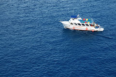 White Motor Boat. And deep blue water Stock Photos