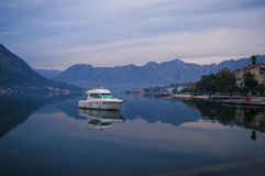 White motor boat at dusk Stock Photos