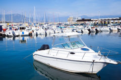 White motor-boat floats moored in marina Royalty Free Stock Photos