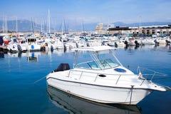 White motor-boat floats moored in marina Royalty Free Stock Photos