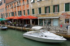 White motor boat near ristorante Alla Conchiglia in Venice, Ital Stock Photography