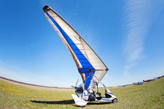 White Motor-glider in the clearing waiting for their turn to fly. Stock Image