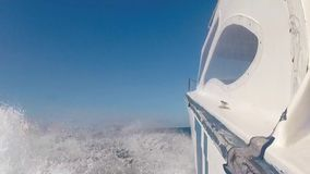 White motor yacht in action, Galapagos Island stock video footage