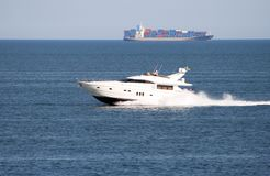 The white motor yacht rushes on the sea stock photos