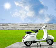 White motorbike on decorate floor in the garden Stock Image