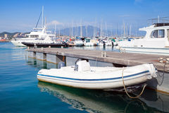 White motorboat floats moored in marina, Ajaccio Royalty Free Stock Photo