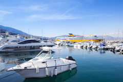 White motorboat floats moored in marina Royalty Free Stock Images