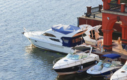 White motorboats tied at the dock Stock Photos