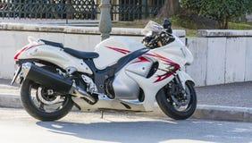 White motorcycle  on the street Stock Photos