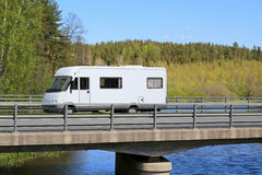 White Motorhome Traveling along Scenic Road Royalty Free Stock Photo
