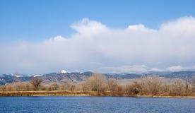 White Mountain Beyond a Bright Blue Lake Stock Photography