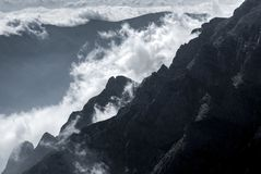 White mountain clouds above high peaks. Inspiring power and spirituality, the spirit of the earth Stock Photos