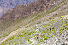 White mountain footpath and group of hikers Stock Images
