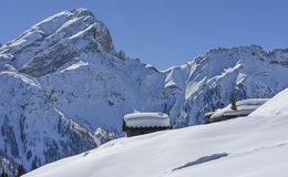 Snowy hut roof, San Pellegrino pass Royalty Free Stock Images