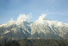 White mountain peaks in clouds Stock Image