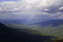 White Mountain Rainbow. Rainbow taken from Mt. Washington, New Hampshire.  Rainbow spans the valley below, with image taken just below cloud level from high atop Royalty Free Stock Photography