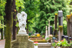 White mourning angel. A white mourning porcelain angel on a cross in Mirogoj cemetery, Zagreb, Croatia Stock Photo