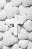 White mourning or condolence background with cross and hearts. Royalty Free Stock Photo
