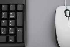 White mouse and black keyboard Stock Images