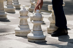 White on the move in chess game. Seniors playing street chess at the park in Banja Luka city Royalty Free Stock Image