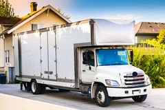 White moving truck. Parked in the alley royalty free stock photography