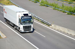 White moving Volvo truck coupled with semi-trailer located on slovak D1 highway. Stock Photography