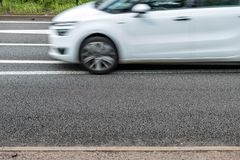White mpv on uk motorway in fast motion.  royalty free stock photos