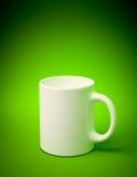 White mug. 3D render of a white mug on green background Stock Images